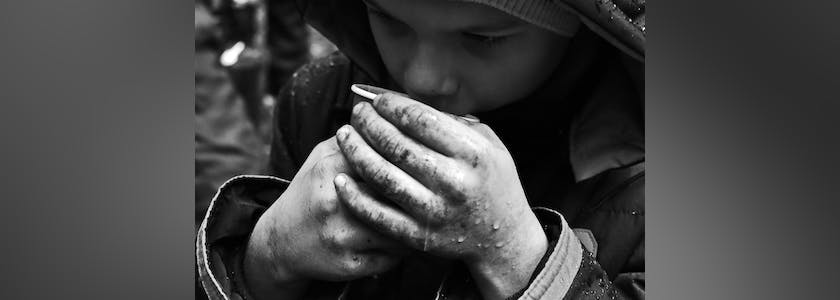 The problem of street children orphans. Beggar refugees on the streets of the city.